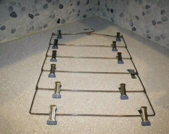 Metal hanger with hooks