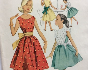 McCall's 8934 vintage 1950's girls dress and pinafore top sewing pattern size 8