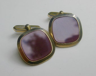old, brown-red glass cufflinks