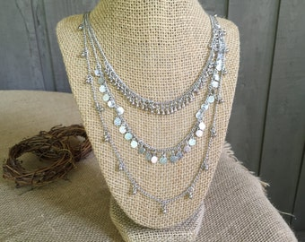 layered necklaces/ chain necklaces/ chains/ multi necklaces/ multi chains/ silver chains/ layered jewelry/ sophisticated necklace/ necklace