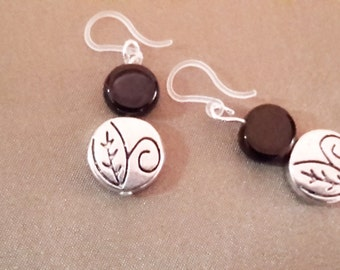 Black and silver disc earrings on plastic french hooks