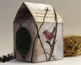 Petite maison en carton à monter.
