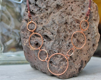 Hammered Copper Necklace With Seven Large Circles  Plus Brown Leather Straps