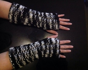 Hand knitted fingerless gloves in the colors black and white