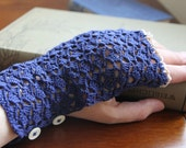 Blue crochet fingerless gloves with beige lace edging and button fastening