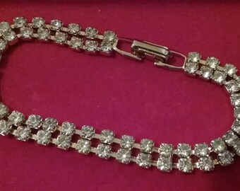 ON SALE****Vintage gold tone clear rhinestone tennis bracelet  7 1/2 inches