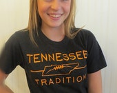 Tennessee Tradition Tee with State outline and football laces in Orange