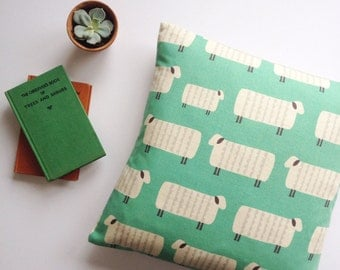 REDUCED! Sheep on mint green backdrop, handmade cushion. Feather insert included.