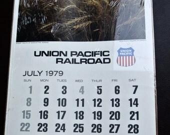 1979 Union Pacific Wall Calendar, Retro Railroad Calendar, Still in Wrapper, 6 Page Calendar, Approx. 12 inches by 23 inches.