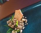 Hylian Shield for Boutonniere in Zelda Wedding