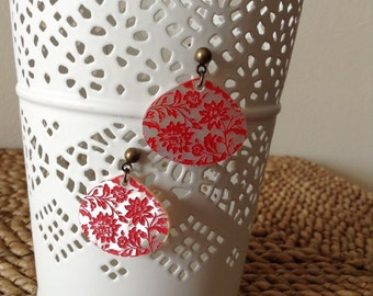 Guitar pick shaped irriedescent shell bronze post stud earrings with deep red coral etched flowers. Perfect beach earrings.