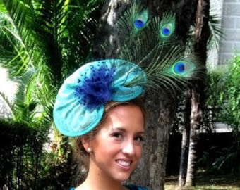 Green and dark-blue headdress with peacock feathers