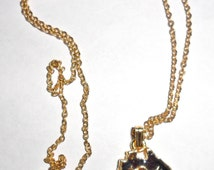 Cute petite vintage 18K gold plated Australia continent pendant necklace with black resin inset faux opal chips and kangaroo