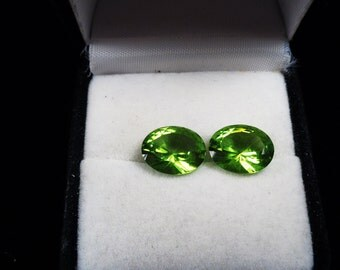 Matching Pair of 12 x 10mm. Chinese Peridot Oval Gemstones.