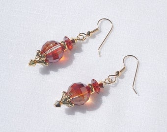 Swarovski red magma crystal and gold earrings