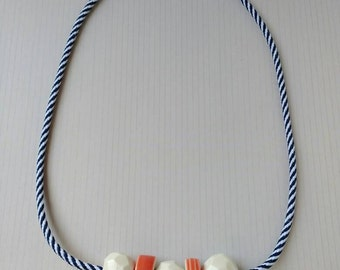 Chunky faceted porcelain beads on a navy and white cord