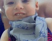 Toddler ajustable bandana. Grey and dark blue airplanes and soft stretch denim back.