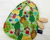 The fairytale forest, extra-large baby bib. Double sided with two buttons. Ideal for the first bites and baby-led weaning.