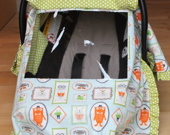 Boy monsters carseat cover with peek-a-boo window and green polka dot ruffles