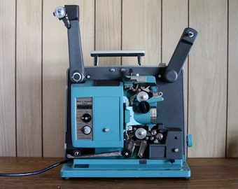 Bell & Howell 545 Filmosound Specialist Autoload 16mm Film Projector: 1960s