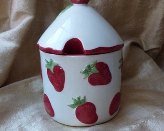 A Strawberry Jam Pot decorated with strawberries.