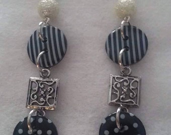 Black and white dangle button earrings
