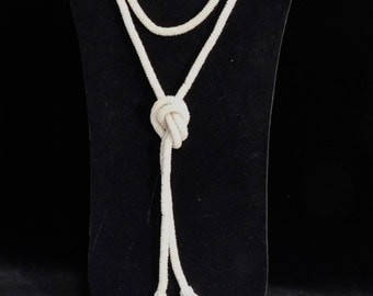White beaded flapper necklace--1920's