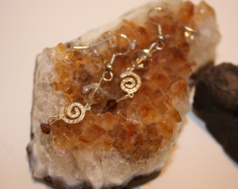 hammered swirls of silver with amber crystals