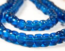 50 Pcs - 9x8mm Transparent Dark Aqua Blue Glass India Crow Beads - Crow Rollers - Glass Pony Beads - Jewelry Supplies