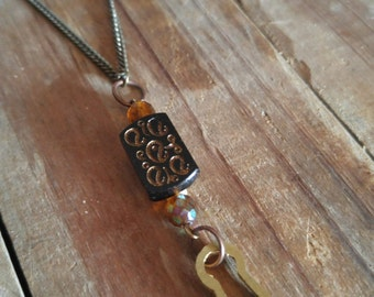 Victorian black glass keyhole necklace