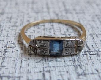 Art Deco Emerald cut Sapphire and Diamond Ring