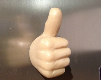 3D fridge magnet giving 'thumbs up'