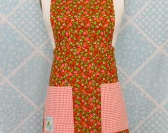 Lovely apron made from Heather Ross fabrics; Briar rose Rust colored floral with peach cotton gingham. Fully lined and functional!
