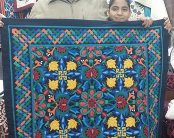 Tarek and his son with New Special Arabian Flower Design . This masterpiece of hand-stitched appliqué Tentmakers of Cairo Art.