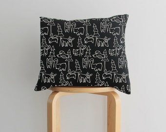 Decorative throw pillow woodland nursery decor in black and white.