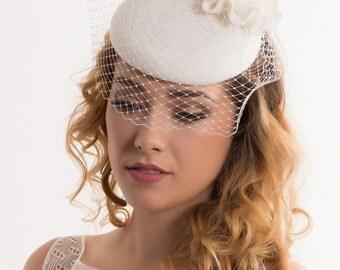Elegant minimalistic bridal hat from english felt wool with flowers and petit veil