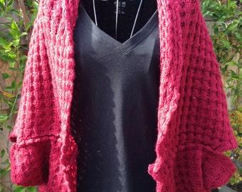 Knitted cardigan. Lattice pattern