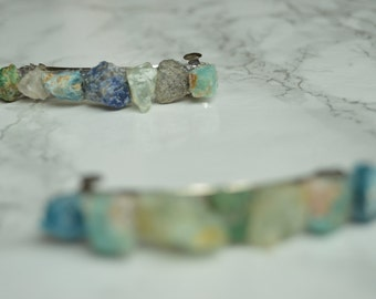 Barrette with various blue stones