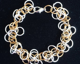 A Shaggy Loop Bracelet with Shiny Aluminum and Bronze rings