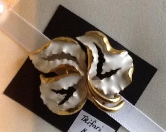 Triafari gold with white enamel leaf brooch