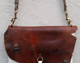 Vintage chap leather and white re-purposed leather convertible shoulder to clutch bag, with horse-tack leather strap.