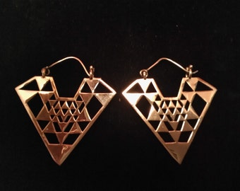 Offer outstanding tribal yantra made in brass. Boho earrings. Tribal yantra brass earrings. Ethnic jewelry. Tibetan geometric earrings.