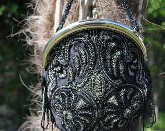Small bag has hand beaded 1900