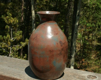Small handcrafted wheel-thrown stoneware pottery vase.