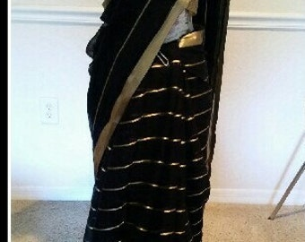 black saree with gloden horizontal lines on it  with gloden work blouse