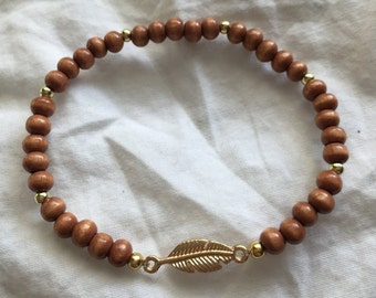 "Wood Beads and Gold Feather Stretch Bracelet (6 1/2"" to 7 1/2"" wrist size)"