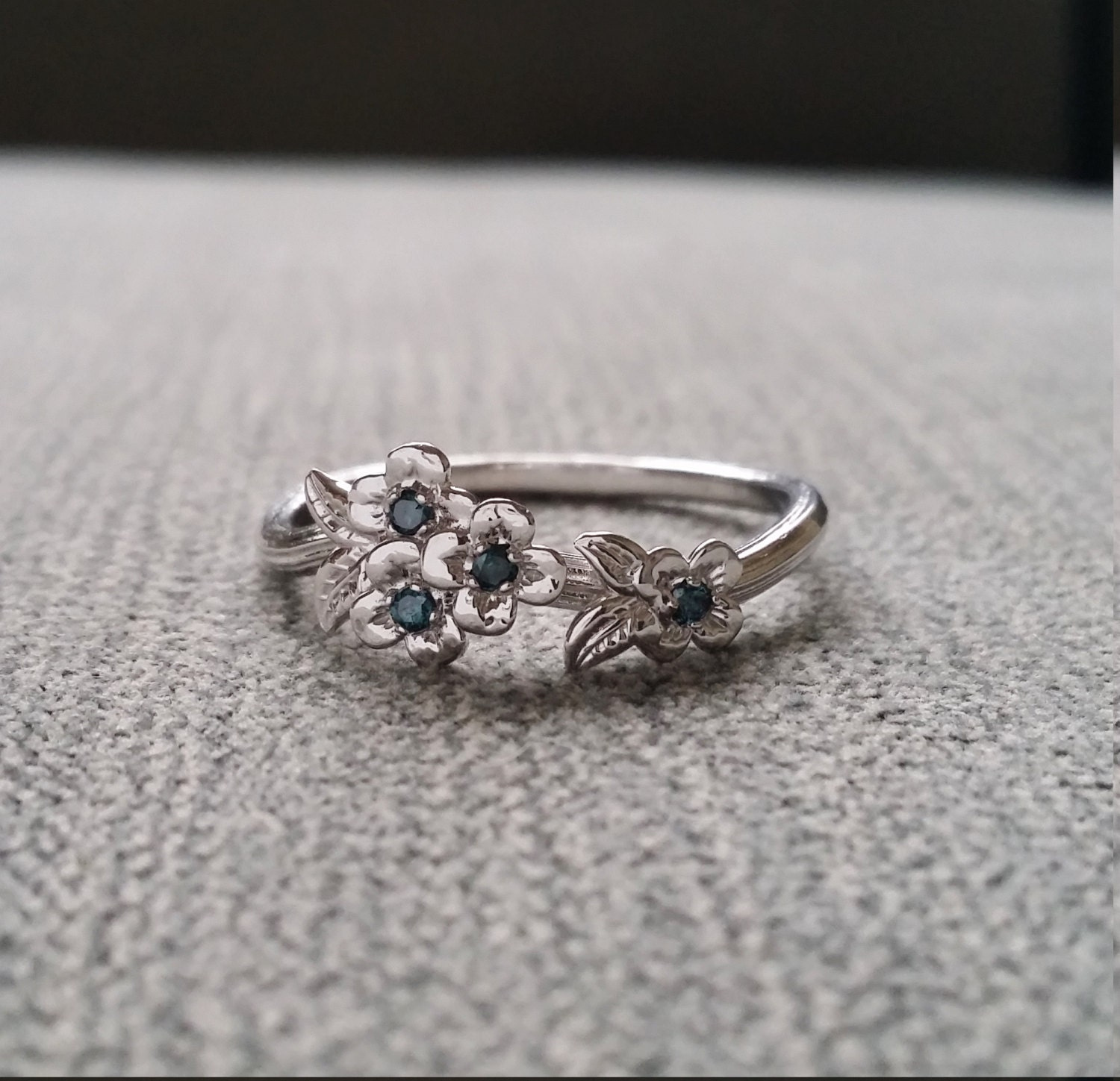 blue gold flower engagement ring delicate floral
