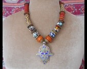 Bohemian Gypsy Lucky amulets necklace: art glass beads, antique Venetian trade beads, enameled Berber hamsa