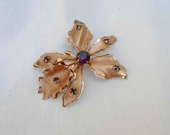 Vintage Mid Century Coppery Rose Colored Orchid Pin / Brooch or Pendant with Purple Colored Rhinestones