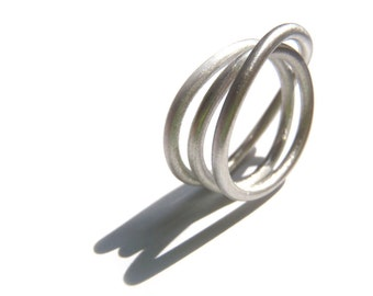 Tangles Ring a minimal design made in your size in sterling round wire